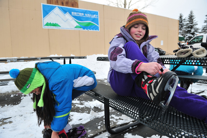 11EPStand Better Late.jpg Halie Childer, 12, and friends lace up at the scating rink on Saturday. Childers was celebrating her birthday several weeks late, as her actual birthday was the weekend of the September flood.