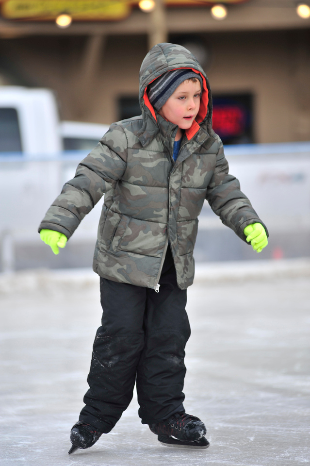 Aiden Danton, 7, glides across the ice of the downtown rink on Saturday. The rink won't be open on Christmas day but will reopen on Thursday.