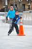 11EPNews Ice Cold.jpg Well-bundled children slide across the ice at the Estes Park scating rink on Saturday. Arctic cold has settled over Estes Park, though warmer temperatures, above freezing, are expected by week's end.