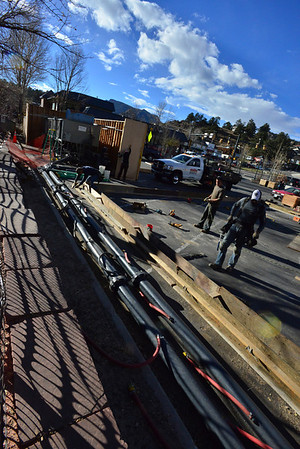 13epicerinkbuild.jpg Monday afternoon, workers piece together the framwork for the temporary ice rink being constructed in the Riverside Parking lot located at the intersection of Elkhorn and Riverside in downtown Estes Park. This is the second year the town and the Estes Valley Recreation and Park District have partnered to provide the temporary rink. Officials hope to have it open by Nov. 21.