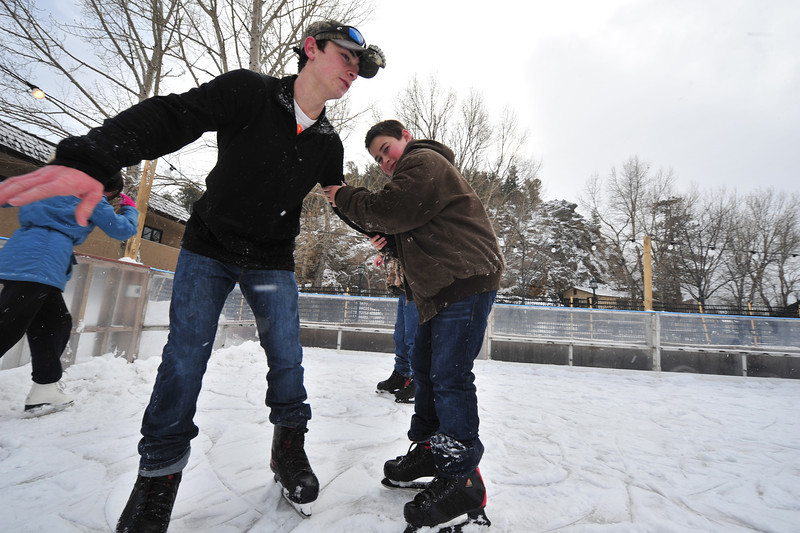 Jimmy Menard, 16, and brother Ryan, 14, from Abbyville, La. enjoy their first experience with snow on Tuesday. The brothers were visiting Estes Park for the first time with their parents who were celebrating their wedding anniversary.