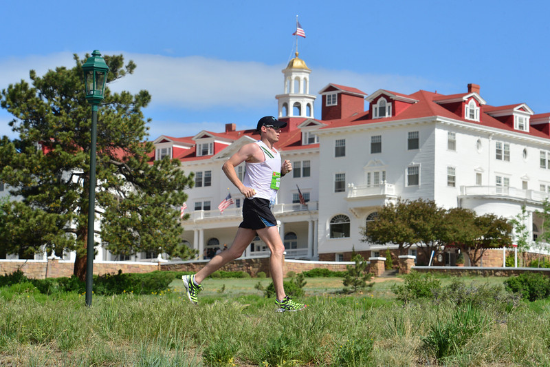 Sean Kearney cruises past the Stanley Hotel, reeling in the last of the runners ahead of him with just a few miles left in Saturday's Estes Park Marathon. The marathon celebrated its tenth year with nice weather and fast times.