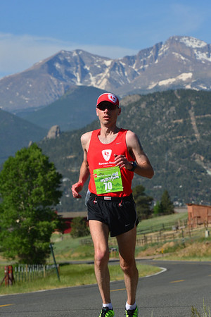 Lenny Laraio, who placed second among the men, trudges up Dry Gulch toward Devils Gulch Road on Sunday. The stretch is the most challenging of the Marathon for many as it is up hill for three miles and offers no shade.