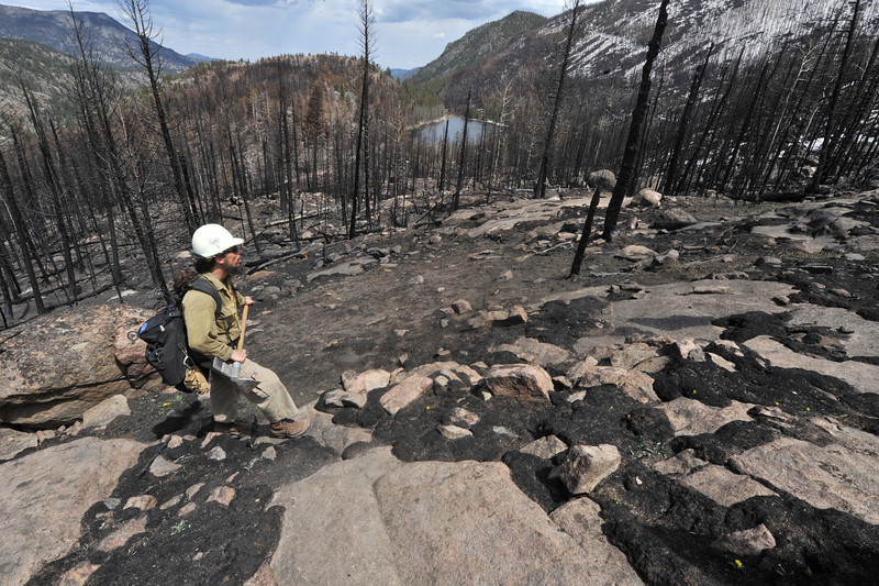 Alpine Hotshot captain Mark Mendoca surveys a slope west of Cub Lake during a hike on Monday. The slope was engulfed by the Fern Lake Fire during the early morning hours of December first, when the fire made a three-mile run due to high winds.