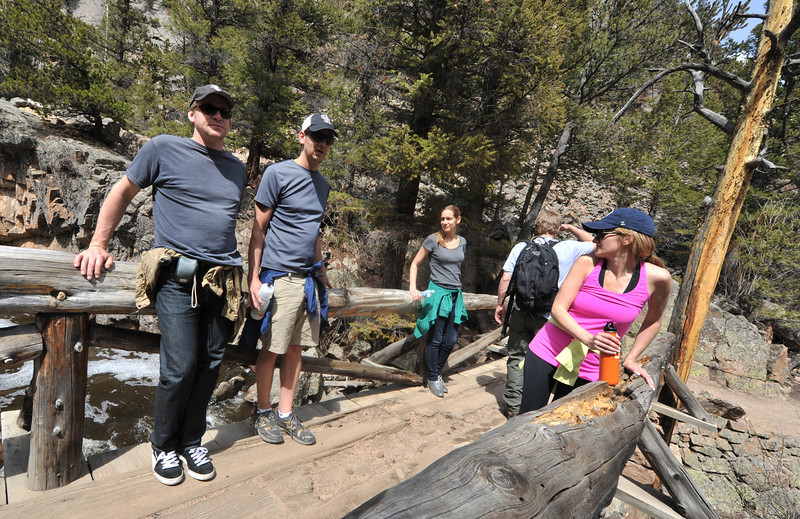 Hikers pause at the Pool in Rocky Mountain National Park this week. With spring weather expected through the weekend, the trails in the national park will be a popular destination.