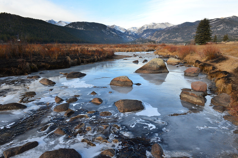 The frozen Big Thompson River cuts through chard grass in Morain Park on Thursday. While warm and dry was the rule for November, Estes Park could see some rain or snow for the second weekend running.