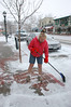 Jerri Paulson clears the walk in front of Mostly Ts storefront on Elkhorn Avenue Tuesday morning. A strong storm front had little impact on Estes Park with just around an inch of snow reported in most places, which also report a light snow falling during the morning. Slick roads were the biggest result of the latest storm as warm temperatures on Monday resulted in the snow melting and then freezing overnight, creating hazardous driving conditions.
