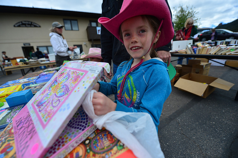 Katheryn Dennis, 6, of Estes Park searches through items at the Estes Park Pet Lodge on Saturday. The event was a fund raiser for the Estes Park Pet Association.