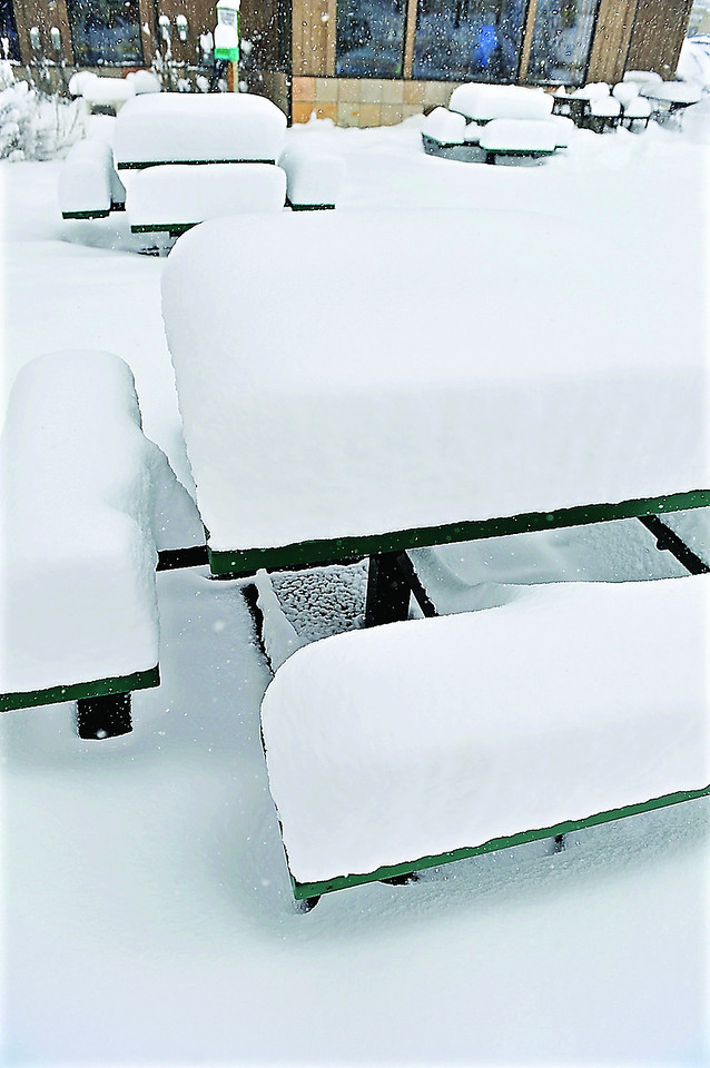 Outdoor tables colect snow on Monday. The tables were a sort of gage, keeping track of the snow fall.