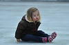 Three-year-old Trinity Rohn of Estes Park tries to scoot across the ice rink at Elkhorn and Riverside Drive on Monday. Families for Estes held the event at the rink for young families with young children.