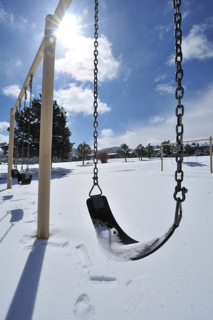 Snow, marked only by other melting snow, covers the Estes Park Elementary School's playground on Tuesday. The latest snowstorm and slick streets prompted administrators to cancel classes on Tuesday.