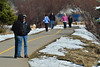 Walkers and bird watchers get out to enjoy warming weather on the Lake Estes Trail on Wednesday. Traffic on area trails will likely increase as temperatures climb into the 60s over the weekend.
