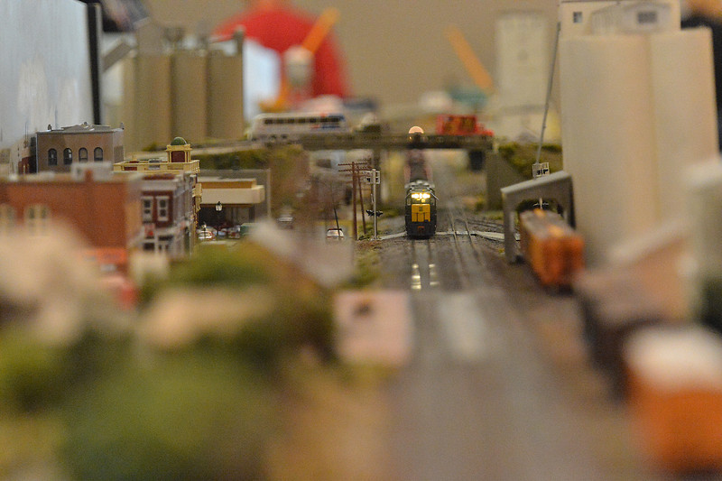 A tiny freight train rumbles through a model farm town at the Rails in the Rockies model train show on Sunday. Model designers often fashion displays to resemble real rail towns and rail lines of the area.