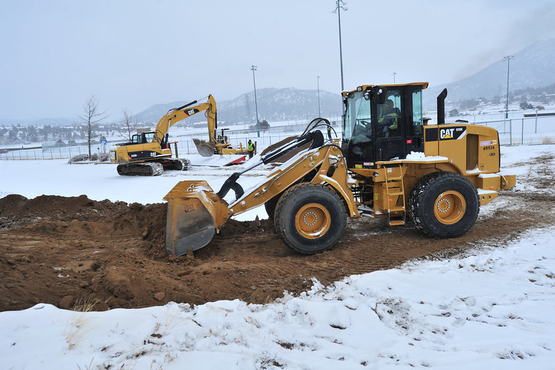 Excavation crews work throught the snow at the Stanley Fair Grounds on Thursday. The workers were preparing to install new sewer lines for the eventual stall barns at the fair grounds.