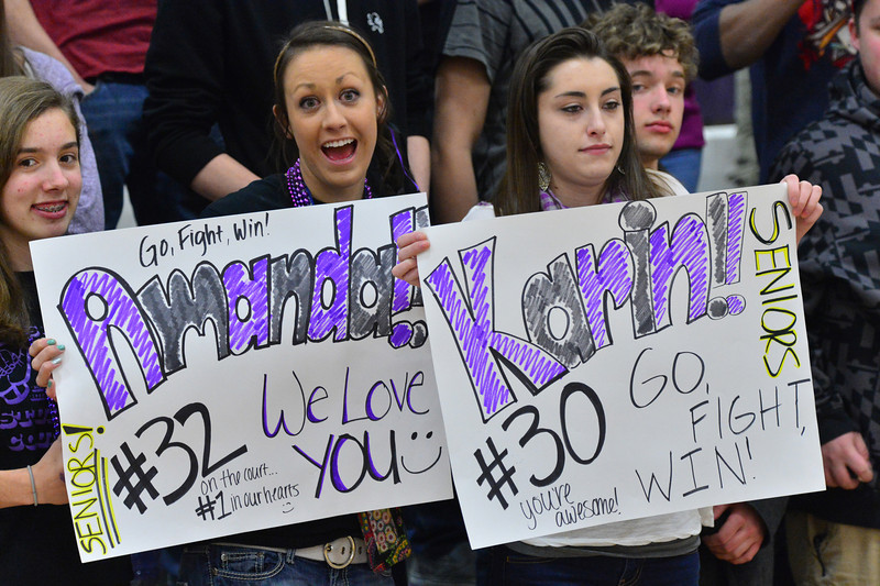 Fans of the Ladycats Basketball seniors show off their enthusiasm on Tuesday night. The seniors played their final home game, and won, on Tuesday night.
