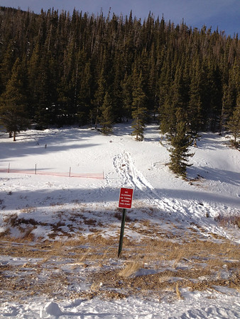 Signs restrict access to portions of the Hidden Valley snowplay area in Rocky Mounntain National Park. The area was still short of snow Sunday afternoon, although more snow was expected by Christmas.