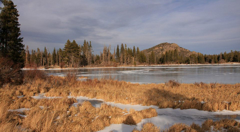 An ice covered Sprague Lake in the late afternoon in mid-December.