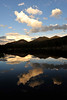 29EP News End of the Day.jpg Walt Hester | Trail Gazette<br /> Clouds and blue sky reflect off of Sprague Lake as afternoon fades into night on Wednesday. The shallow lake is a favorite among national park visitors, as well as elk and moose.