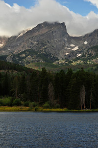 31EP News Stormy Weather.jpg Walt Hester | Trail Gazette Clouds cling to the tops of Divide peaks towering over Sprague Lake on Monday. The respite was brief as heat returned Tuesday.