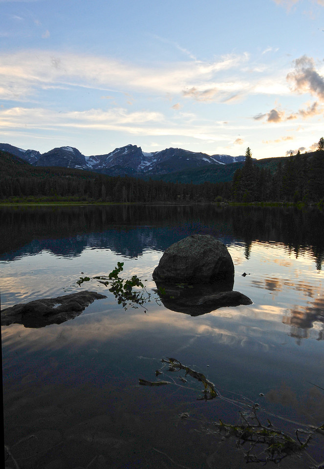 29EP StndAln Lake & Divide.jpg Walt Hester | Trail Gazette<br /> Evening light fades over the Continental Divide and Sprague Lake on Wednesday. Heavy spring runoff deposited much debris into the lake.