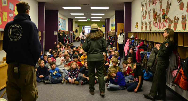 Rocky Mountain National Park Rangers Kathy Brown, center, and Kyle Patterson, right, spoke to Estes Park Elementary students Monday morning.