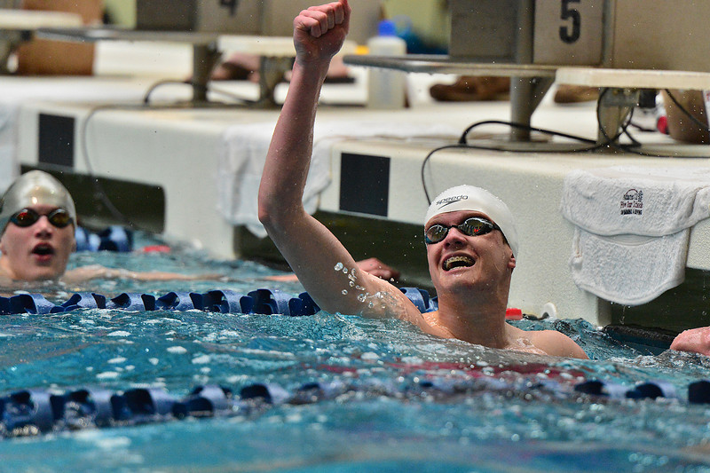 Estes Park swimmer Forrest Beesley celebrates after breaking his own record in the 100-meter freestyle at Saturday's 4A State Swimming and Diving Meet. Beesley had a hand in breaking at least three school records, two of them with the help of teammates in the 200 and 400-yard freestyle relays.