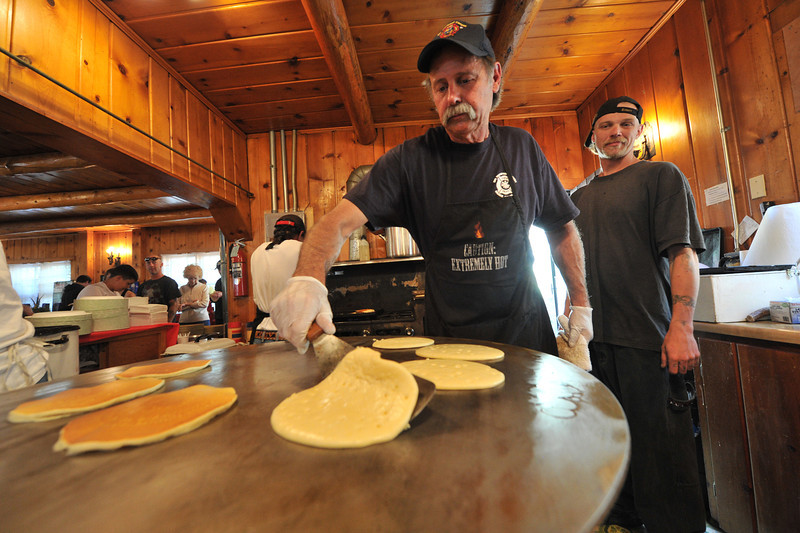 Dave Legits of Drake flips pancakes on a rotating, circular griddle at the Big Thompson Canyon Association pancake breakfast on Sunday. The money made from the breakfast will go to fund BTCA activities as well as the Big Thompson Canyon Volunteer Fire Department.