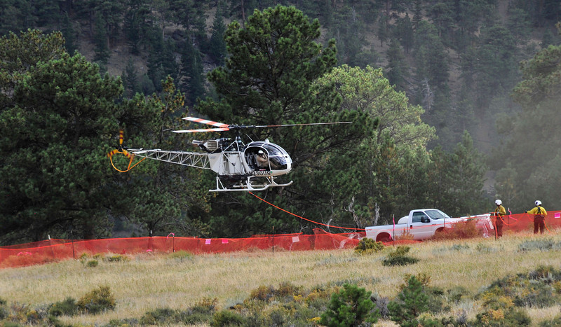 Photo by Walt Hester<br /> A helicopter lands behind the visitors center at Beaver Meadows on Wednesday. The aircraft was flown in from Wyoming to help monitor the Cow Creek Fire flair up.