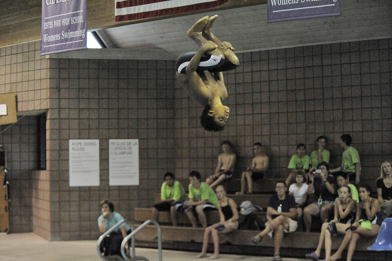 Photo by Walt Hester<br /> Middle school diver Jake Bielmeier hangs over the water during Wednesday's swim meet at the Aquatic Center. Bielmeier has been earning scores that would earn an older diver a trip to the state meet.