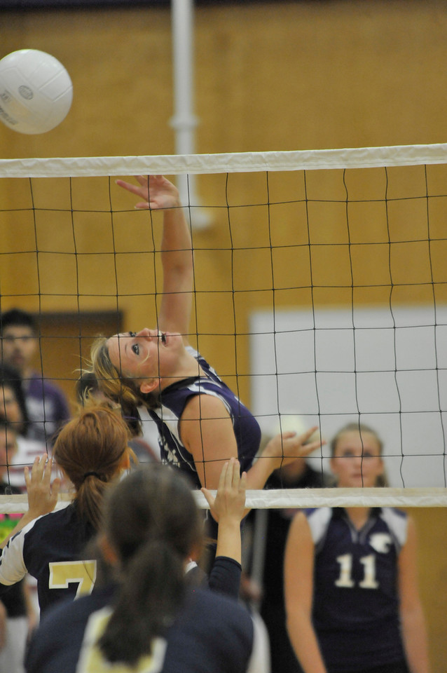 Photo by Walt Hester<br /> Estes Park's Kyra Stark redirects a pass over the net against the visiting Nederland Pathers.