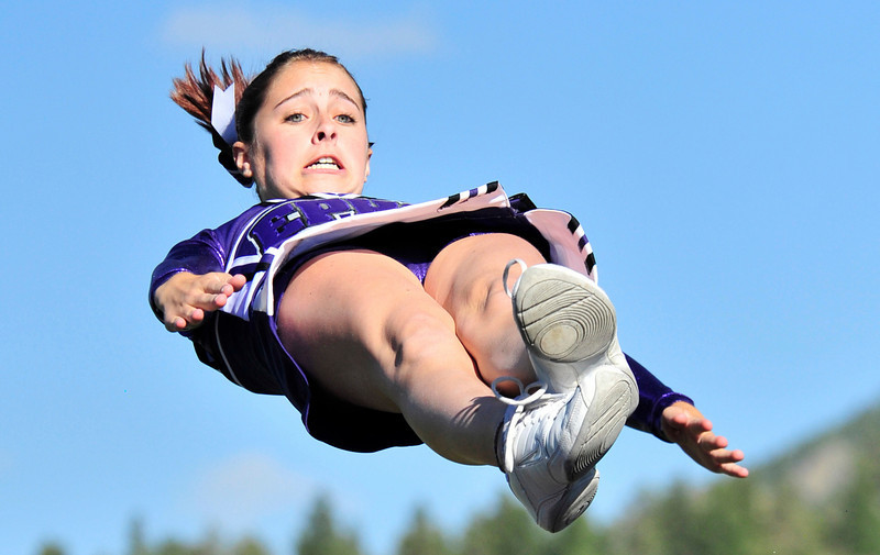 Photo by Walt Hester<br /> Cheerleader Ernie Hardin braces for her landing at halftime of Thursday's soccer game. The cheerleaders are again performing stunts and plan to compete in this year's state meet.