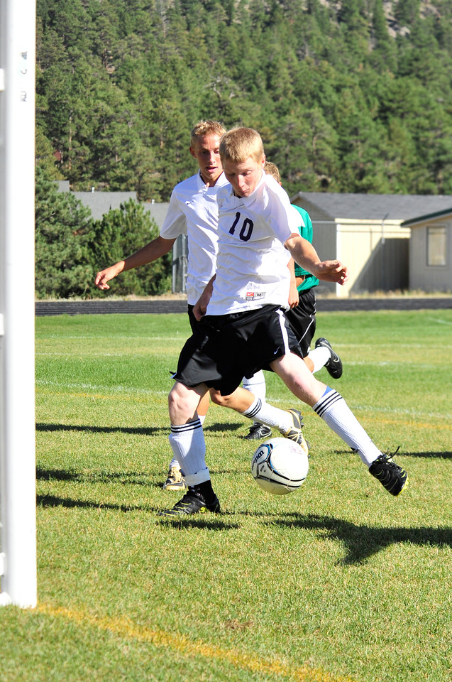 Photo by Walt Hester<br /> Estes Park's Cain Bratrud gets an open shot from five feet infront of the Heritage Christian net in the first half of Thursday's game. The 'Cats beat the visiting Eagles 5-3.