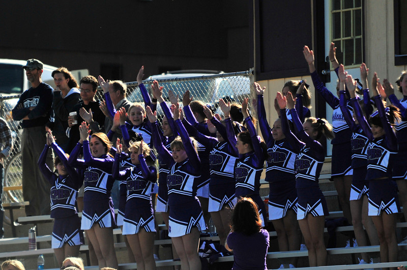 Photo by Walt Hester<br /> The Estes Park High School cheerleaders shout and cheer for the Estes Park Bobcats' soccer team during the team's home opener.