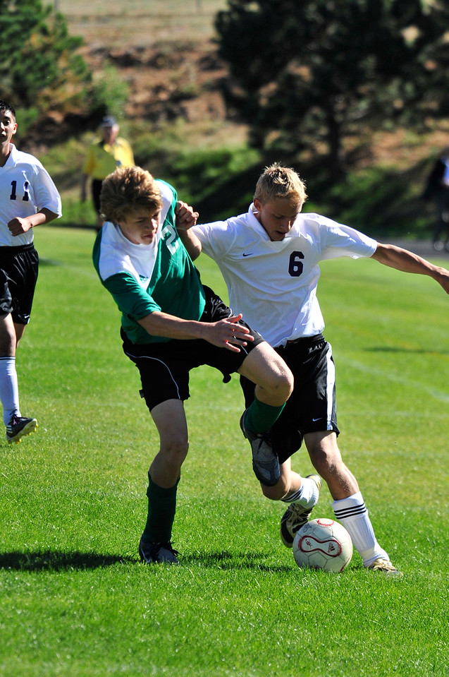 Photo by Walt Hester<br /> The Bobcats' Andrew Cirone jousts with a Heritage Christian defender during the first half of the Estes Park winover the visiting Eagles. Cirone tallied a goal and an assist in the home opener.