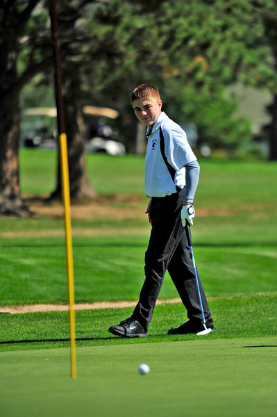 Photo by Walt Hester<br /> Estes Park golfer Will Casey watches as a ball just misses the hole during Thursday's golf tournament.