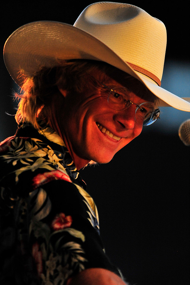 Photo by Walt Hester<br /> Cowboy Brad Fitch smiles during Saturday's John Denver Tribute Concert. Fitch donates proceeds from the show to Denver's favorite causes.