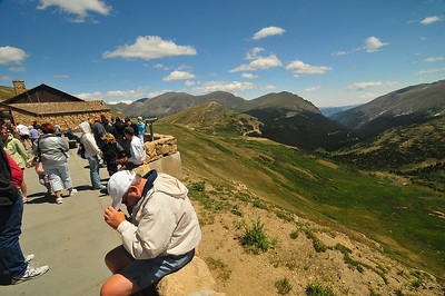 Photo by Walt Hester Visitors flock to the viewing deck of the Alpine Visitors Center to look down from more than 11,000 feet. The visitors center sits on Trail Ridge Road where it intersects with the park's first vehicle path, the Old Fall River Road at Fall River Pass.