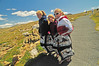 Photo by Walt Hester<br /> Nebraska natives, from left, Chelsea Entz, 17, Kelli Bauer, 15, and Kara Ostrand, also 15, skip down the Tundra Communities Trail while covering themselves in a quilt. The cool tundra and stiff winds made for an uncomfortable visit to the top of Trail Ridge Road.