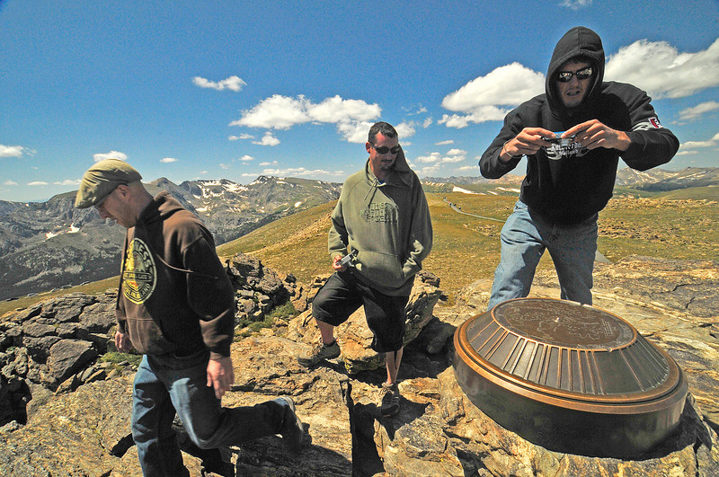 NOTE: THIS IS THE LEAD PHOTO<br /> Photo by Walt Hester<br /> Rob Luhrs photographs the Roger Wolcott Toll Mountain Index above Rock Cut along the Tundra Communities Trail with friends Nathan Decker, left, and Lance Milligan, all from Omaha, Nebr. The index shows visitors the mountains in all directions.