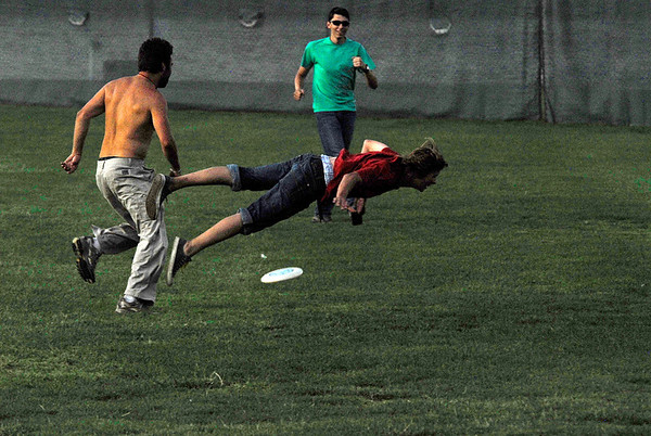 Photo by Walt Hester<br /> Ferdi Lorenz, 16, of Munich, Germany overshoots the disk in a game of Ultimate in Stanley Park on Monday. The teen was part of a youth adventure camp called Ultimate Colorado and had climbed and kayaked before landing in Estes Park.