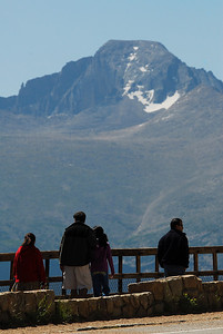 Photo by Walt Hester Longs Peak looms over visitors at Many Parks Curve. Many Parks Curve is where the park closes Trail Ridge Road in winter.