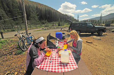 Photo by Walt Hester Lisa Karnish, left, and Allie Eichenhofer, both from Fort Washington, Wis., enjoy lunch in the Timber Creek Campground on Sunday. The camp[ground will be temporarily closed while Rocky Mountain National Park completes a paving project.