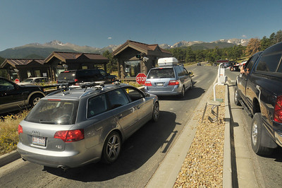 Photo by Walt Hester Cars crowd into the Beaver Meadows Entrance Station on Sunday. The park will be having another free day next weekend.