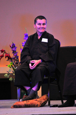 Photo by Walt Hester<br /> Zen buddhist Cheri Maples of Madison, Wis. sits on a panel answering questions about living a mindful life during a retreat at the YMCA of the Rockies on Tuesday. Maples had been a police captain in Madison Wis. when she began practicing non-violence and mindfulness, and has since been ordained by Zen master Thich Nhat Hanh to teach this practice to others.
