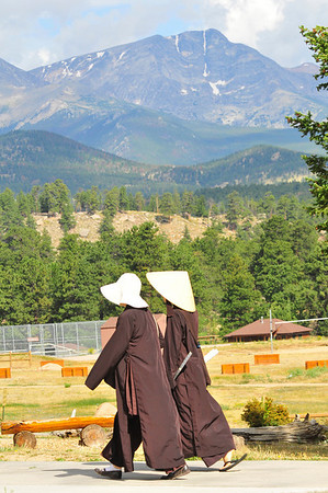 Photo by Walt Hester<br /> Two buddhist nuns walk across the grounds of the YMCA on Tuesday. The YMCA of the Rockies - Estes Park Center hosted a mindfulness retreat lead by Zen master Thich Nhat Hanh.