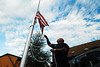 "Photo by Walt Hester<br /> ______________, assistant maintenance manager for the Worldmark resort, raises ""Old Glory"" over the resort on Wednesday morning. Many flags were lowered to half-staff across the nation to honor Sen. Ted Kennedy, who lost his year-long battle with brain cancer late Tuesday night."