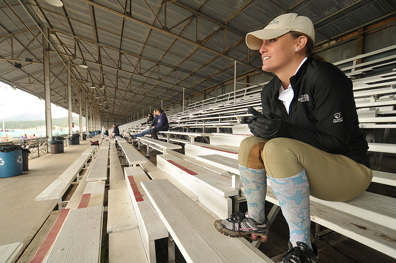 Photo by Walt Hester<br /> Laura Long watches the Hunter Jumper show from the grand stands of Granny May Arena on Thursday. Discussions about the grandstands' future, including possible replacement are continuing.