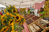 Photo by Walt Hester<br /> Sunflowers and strawberries belie the chill at Thursday's Farmers' Market. Temperatures hovered in the low 60s and 50s, but temperatures should rebound for the weekend.