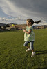 Photo by Walt Hester<br /> Jessica Beck, 6, spins and makes bubbles in the infield during the Relay for Life. The organizers planned activities throughout the night to keep spirits up and children occupied.