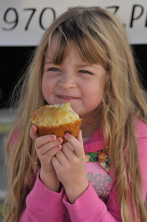 Photo by Walt Hester<br /> Haddi Thompson, 5, of Estes Park enjoys a treat at her parents both, the Estes Pie Company, on Thursday.